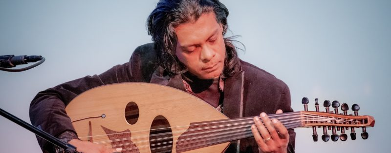 Oliver Rajamani playing a unique guitar.