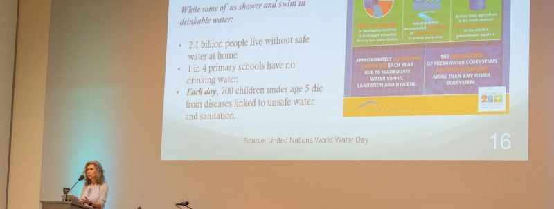 PACS director Shirin Khosropour giving a talk on clean water.