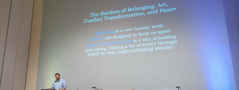 Peter Bonfitto introducing a symposium on the Borders of Belonging: Art, Conflict Transformation, and Peace