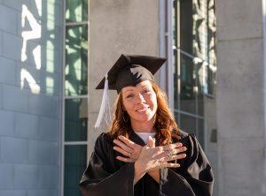 Austin Community College graduate poses