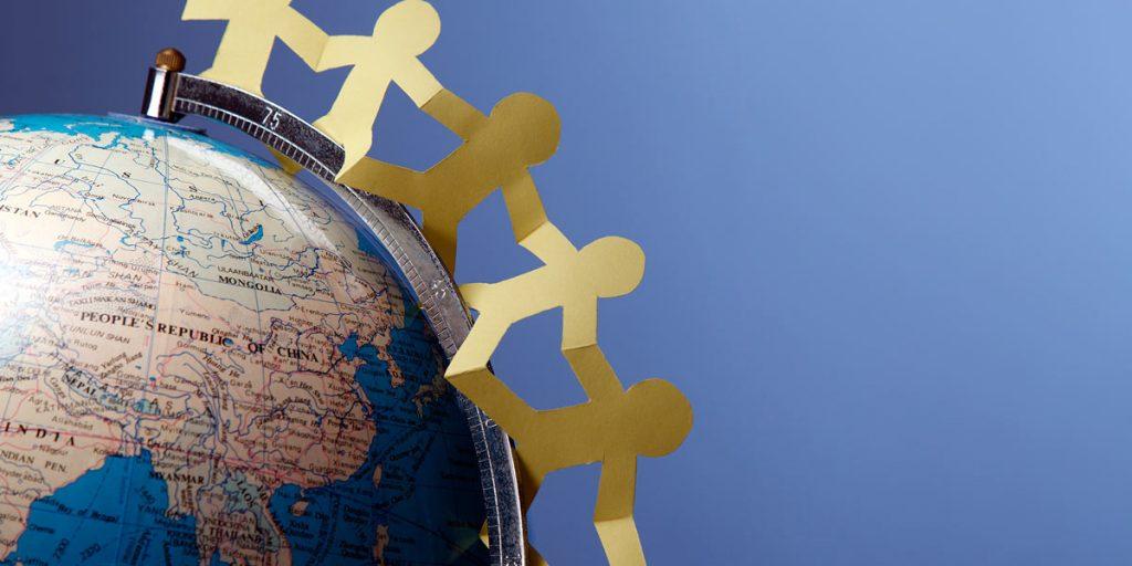 cutout people on a globe